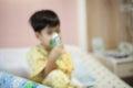 Little boy wearing oxygen mask on face in hospital ward Royalty Free Stock Photo