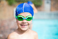 Little boy wearing swimming goggle and cap Royalty Free Stock Photo