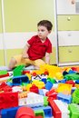 Little boy who play with plastic cubes Stock Photography