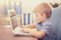 Little boy working on the laptop Royalty Free Stock Photo
