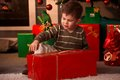 Little boy wrapping out christmas present Stock Photo