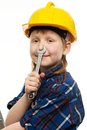 Little boy with wrench tool in protective helmet having fun Royalty Free Stock Photography