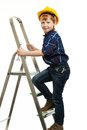 Little boy with wrench tool in protective helmet on a ladder Royalty Free Stock Photo