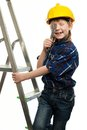 Little boy with wrench tool in protective helmet on a ladder Stock Photos