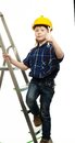 Little boy with wrench tool in protective helmet on a ladder Royalty Free Stock Image