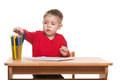 Little boy writes at the desk Stock Photography