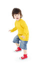 Little boy in yellow shirt stands and warily looks away isolated on white background Royalty Free Stock Photo