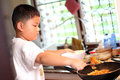 The little boys are cooking Stock Photography
