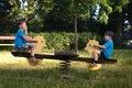 Little boys on seesaw happy in park Stock Photo