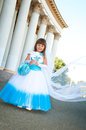 Little bride girl lush white blue wedding dress veil Stock Image