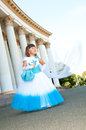 Little bride girl lush white blue wedding dress veil Stock Photo