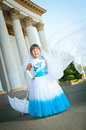 Little bride girl lush white blue wedding dress veil Royalty Free Stock Photo