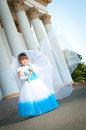 Little bride a girl in a lush white and blue wedding dress veil Royalty Free Stock Images