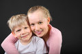 Little brother and sister embrace Royalty Free Stock Photos