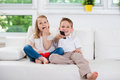 Little brother and sister watching tv Royalty Free Stock Photo