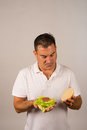 Little burger guy unhappy with his far too light full of veggies Stock Photo