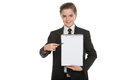 Little businessman with clipboard cheerful boy in formalwear holding and pointing it while standing isolated on white Royalty Free Stock Image