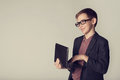 Little businessman holding laptop in his hands Royalty Free Stock Photo