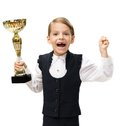 Little businesswoman with golden cup happy gesturing half length portrait of handing and isolated on white concept of leadership Stock Photography