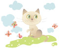 Little cat playing with butterflies Stock Images