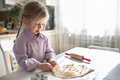 Little Caucasian girl baking in the kitchen  , casual lifestyle Royalty Free Stock Photo