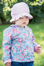 Little caucasian girl in the modern jacket with hat children s fashion Stock Photography