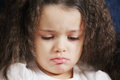 Little caucasian upset girl head and shoulders portrait Stock Images