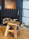 Little chair in front of a fireplace