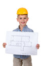 Little cheerful builder in yellow hardhat with paper plan in hands, isolated on white Royalty Free Stock Photo