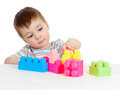Little cheerful child with construction set Royalty Free Stock Images