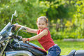 Little cheerful girl on old bike beautiful in park Stock Photo