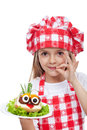 Little chef with creative food onion hair on meatball eyed creature isolated Royalty Free Stock Photo