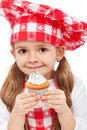 Little chef holding muffin Royalty Free Stock Image