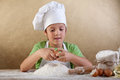 Little chef preparing the dough for cookies Stock Image