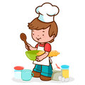 Little chef preparing to cook a boy who wears a uniform and holds kitchen utensils is something delicious Stock Photo