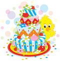Little chick with a cake small yellow chicken and fancy colorful pie for holiday Royalty Free Stock Images