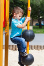 Little child climb at playground without helmet dangerous Stock Photo