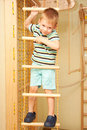 Little child climbing on rope ladder a Stock Photo