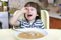 Little child dont want to eat crying boy pea soup Stock Images