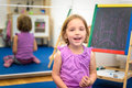 Little child is drawing with color chalk on the chalk board Royalty Free Stock Photo