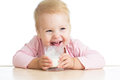 Little child drinking yogurt or kefir over white Stock Photo