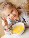 Little child eating soup Royalty Free Stock Photos
