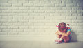 Little child girl crying and sad about brick wall Royalty Free Stock Photo
