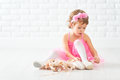 Little child girl dreams of becoming ballerina with ballet shoe Royalty Free Stock Photo