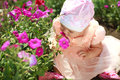 Little child girl enjoy aroma of the flower Stock Image