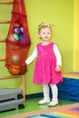 Little child girl playing with ball in kindergarten in montessori class preschool Stock Photos