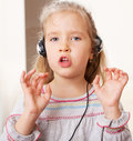 Little child with headphone singing Stock Photo