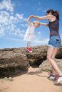 Little child holding hands woman jumping from rocks Royalty Free Stock Photo