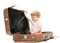 Little child inside a big suitcase Royalty Free Stock Photography