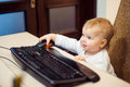 Little child with keyboard Royalty Free Stock Photo